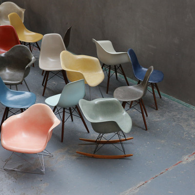 Group of Eames plastic shell chairs with LAR at the front