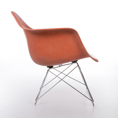 Portrait view of a 1st edition Eames LAR for Zenith Plastics