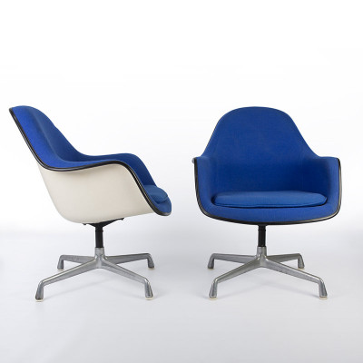 Pair of blue Eames EA178 Loose Cushion Arm Chairs with universal base & floor glides