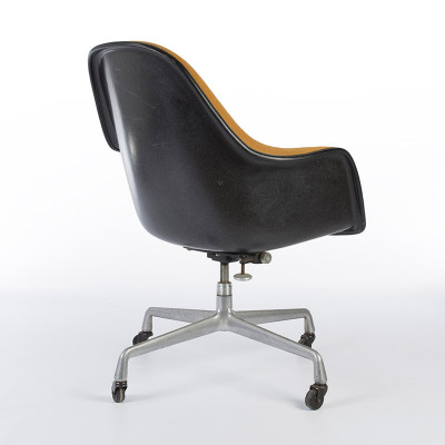 Black EA178 Eames Loose Cushion Arm Chair from the rear showing tilting torsion bar