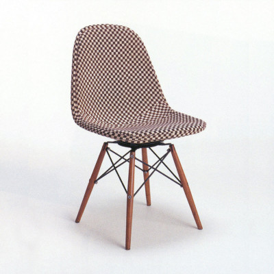 PKR fully upholstered in Mini Check fabric designed by Alexander Girard