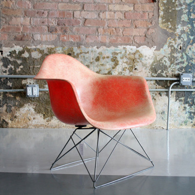 Early Eames LAR arm chair in red orange (image courtesy of Circa Modern)