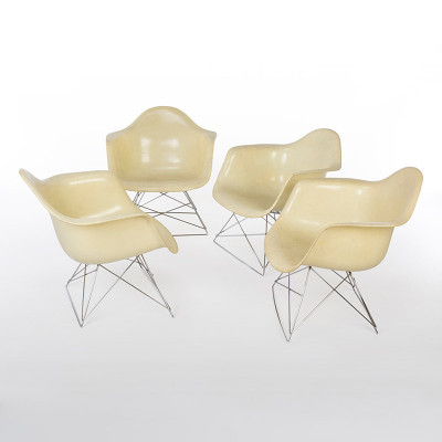 Group of first edition Eames LAR chairs in faded yellow for Zenith Plastics